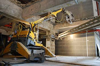 Brokk Controlled Demolition Machine Removing Concrete Slab